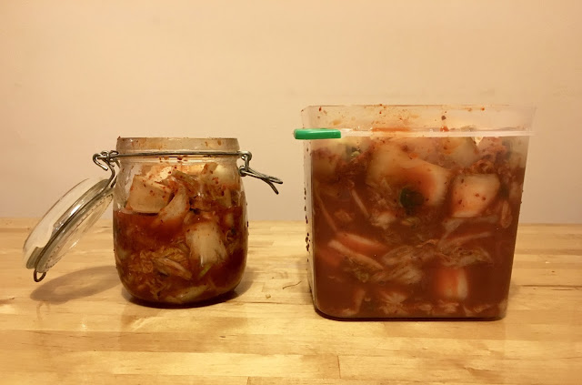 homemade kimchi in two jars