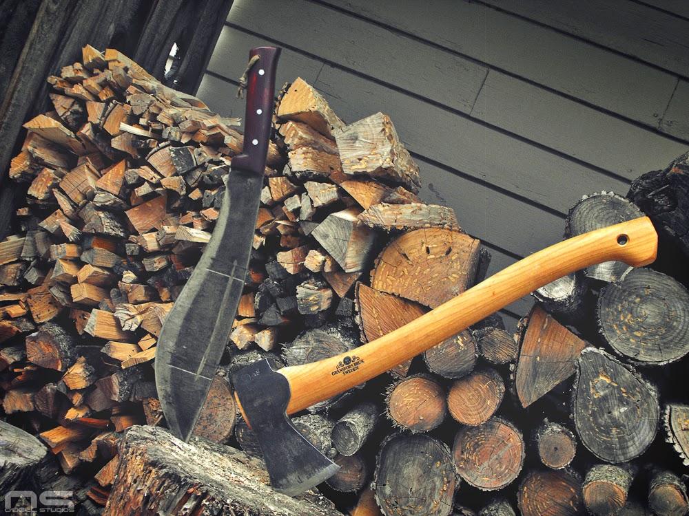 splitting wood with big knives camp knives jungle machete