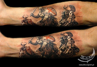 Fore-arm tattoo: mounted medieval knights