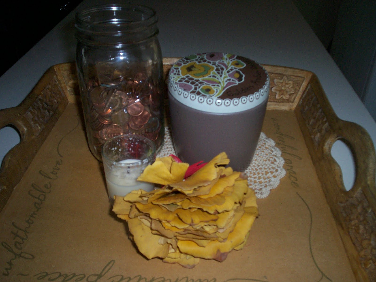 Leigh kramer i started with a ball jar that collects pennies then i added the anthro candle a votive and the dried gingko leaves from last fandeluxe Images