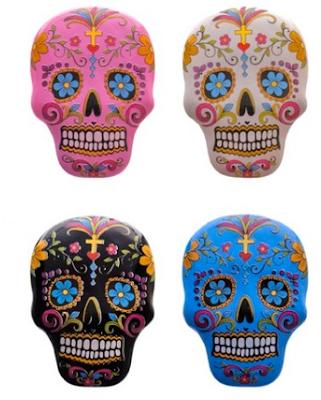 four sugar skull magnets