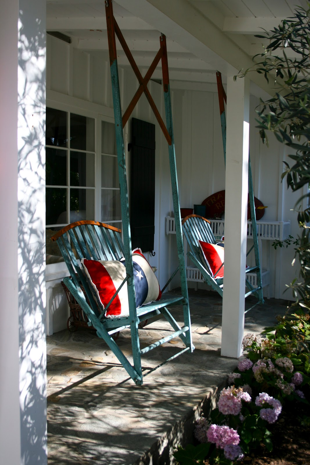The polished pebble vintage porch swings american for Old porch swing