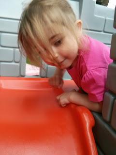 climb up a slide