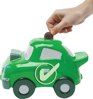 Green money box shaped in car with white tick and hand putting coin in