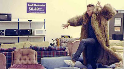 Macklemore-in-his-first-video-shopping-at-thrift-stores-in-thrifted-fur-walking-on-second-hand-chairs-vintage-shopping-101