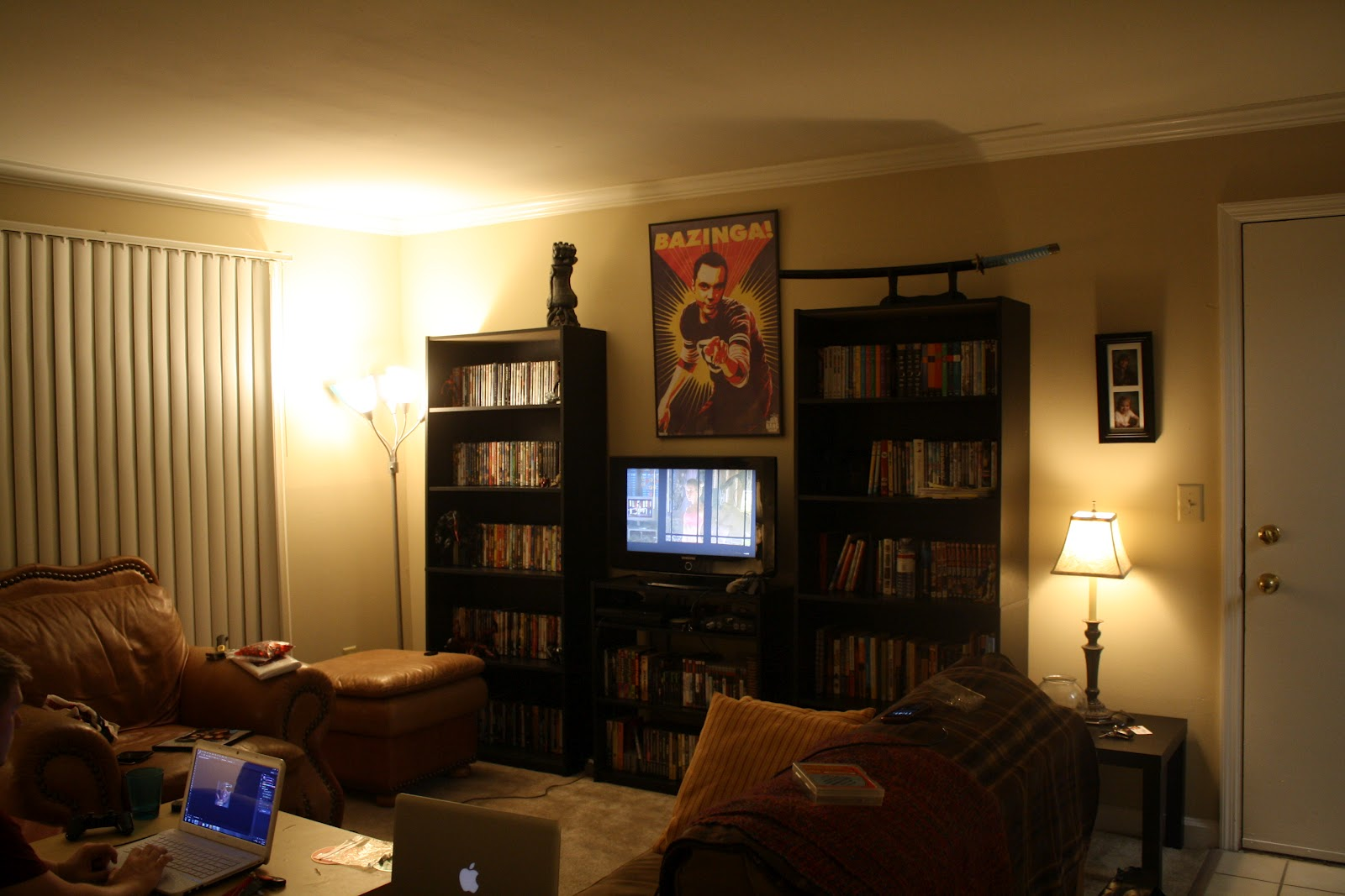 This is part of our living room which is showing you our DVD  video game  and book collection  We got a PS3  PS2  Wii and an N64. music city mallorey  Welcome to our Nerd Cave