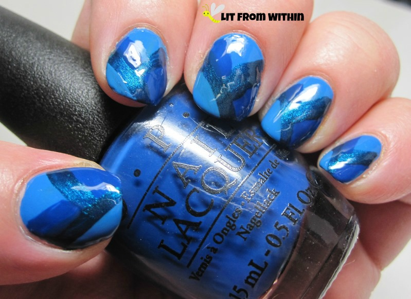 modified fishtail with OPI Keeping Suzi At Bay, a medium blue jelly, and Sally Hansen Insta Dri Teal-y Fast