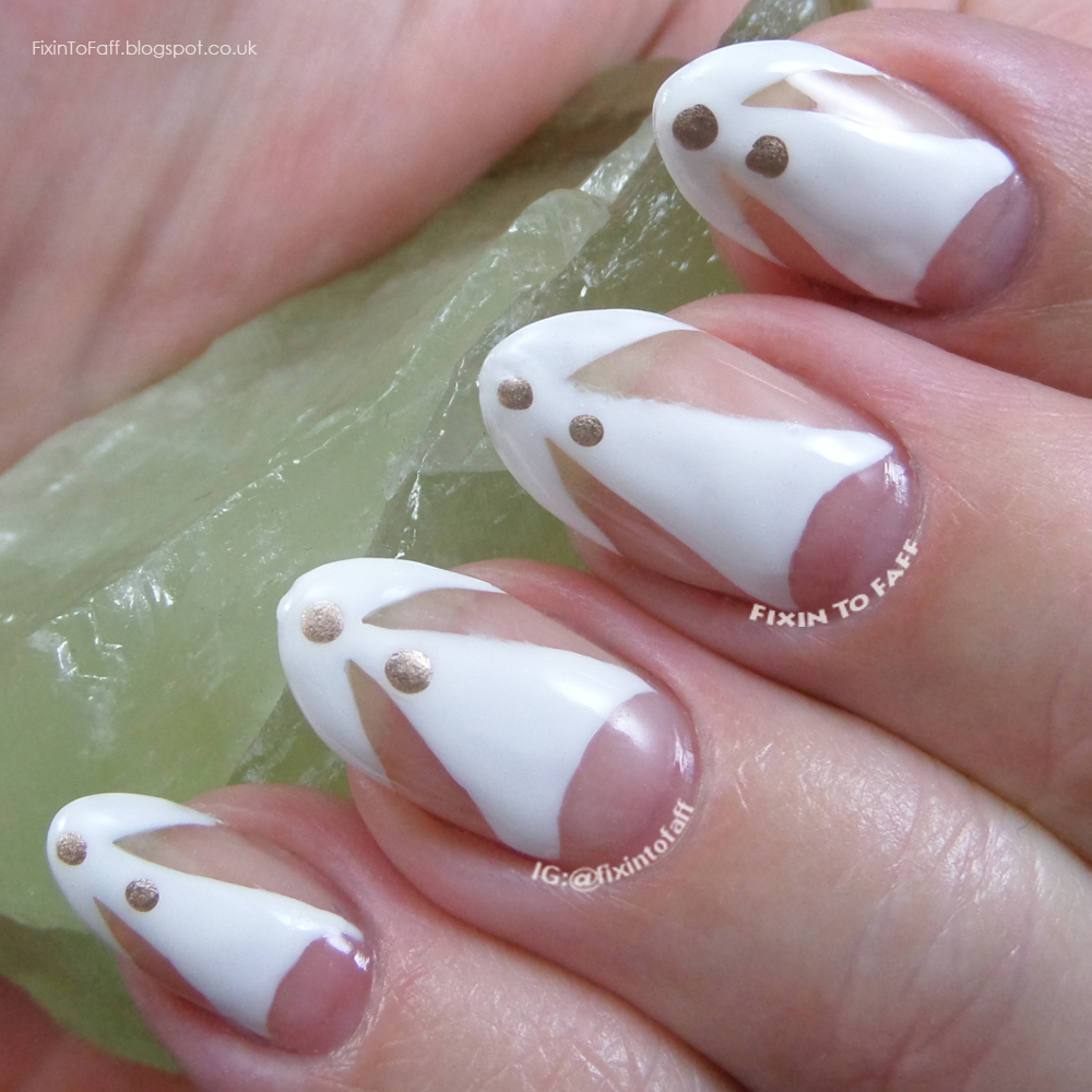 Funky white negative space nail art look inspired by fashion for the Nail Challenge Collaborative.