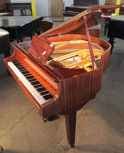 For joel harrison and neil ridley 39 s writing work please for Big grand piano