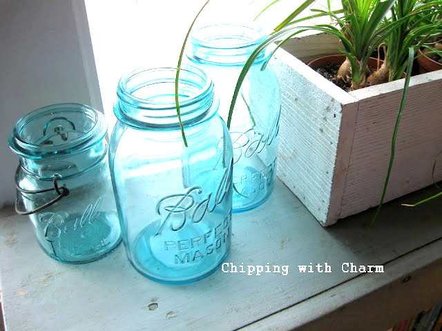 mason jars illuminated in a window