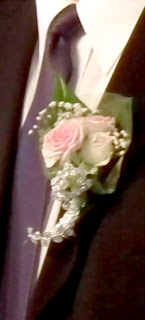 Boutonniere with pink roses and scented pelargoniums leaves