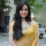 Sana Khan Looks Super Hot In Yellow Saree At The Music Launch Of Tamil Film Nadigayin Diary