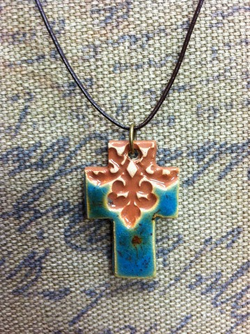 http://www.rescueoneproject.org/collections/rescueoneproducts/products/traditional-cross-necklace
