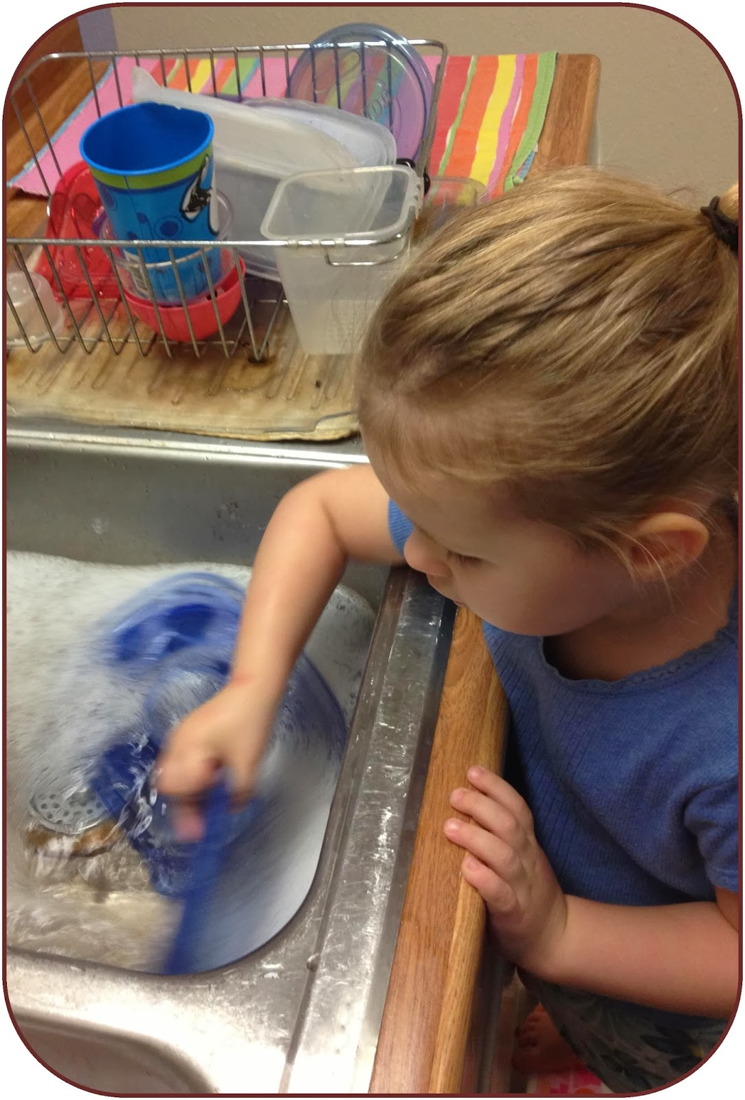 Kids can help wash and rise dishes as a way to help with chores and play in the water, too!   www.lifeinrandombits.com #kids #chores #play