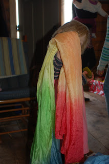 Want to learn how to dye DIY Waldorf play silks?? Follow this easy tutorial to make beautiful rainbow Waldorf play silks and save tons of money!
