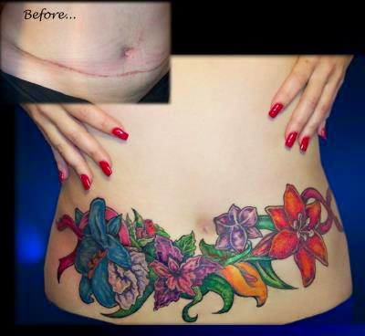 flower tattoo girl stomach.