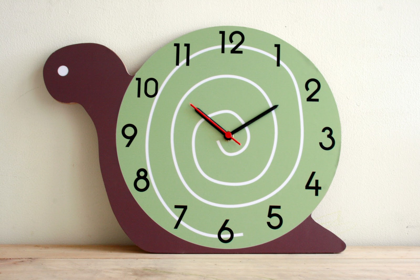 snail clock by squiggle elle clock by squiggle birdie clock by ...