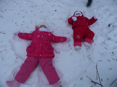 The girls attempt to draw a snow angel