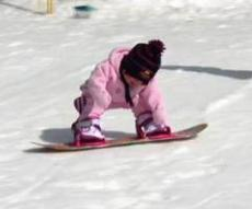 Toddler Riding a Snowboard