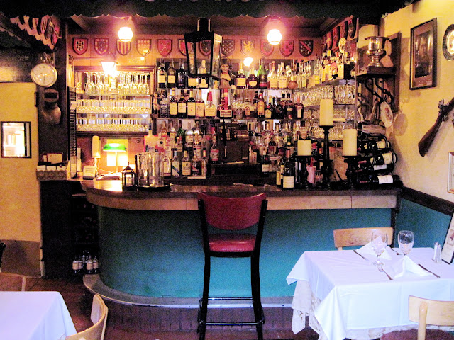 One stool provides the perfect spot for a quick drink at the Old New York establishment Chez Napoleon