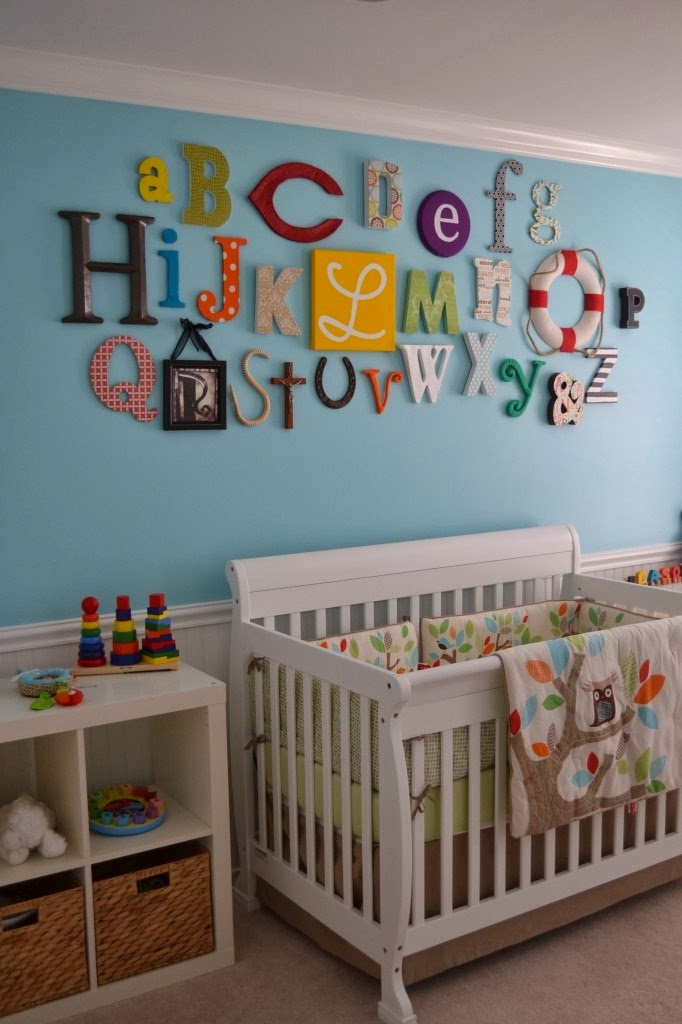 http://projectnursery.com/projects/colorful-gender-neutral-nursery/