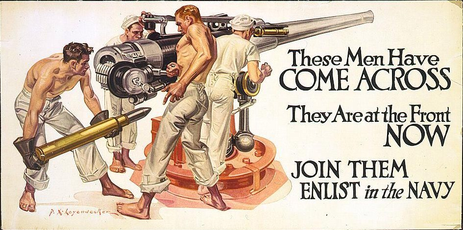 shirtless hunks loading a cannon