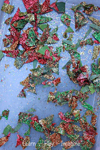Cutting up sparkly leaves to make fall clean mud