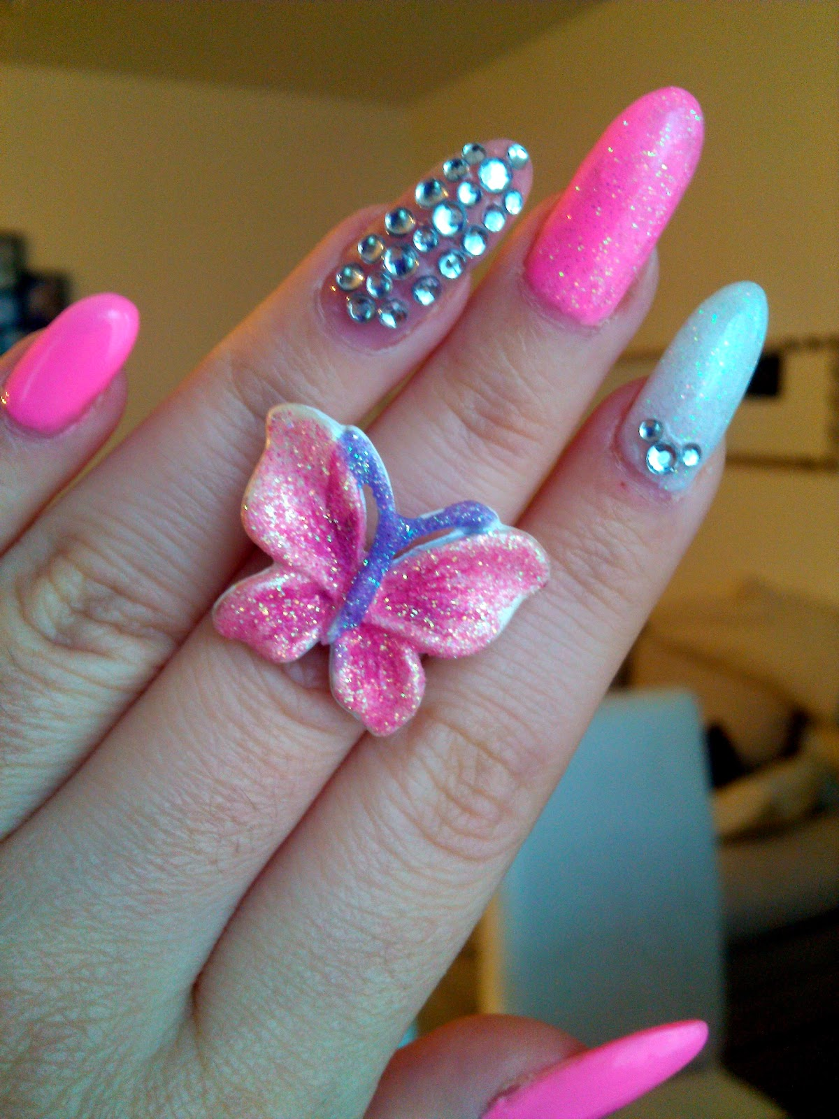 sparkly stiletto nails, stiletto nails, stiletto nails with rhinestones, white stiletto nails, pink stiletto nails, pink butterfly ring
