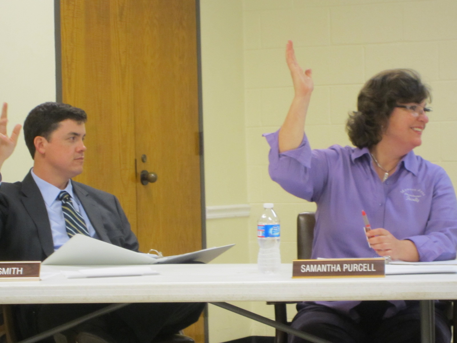 council members toby smith and samantha purcell vote in the affirmative for one of the businesses that evening
