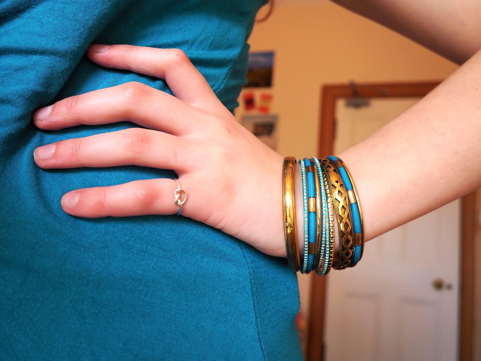 Blue Jeans outfit jewellery details - blue and gold bangles, silver knot ring