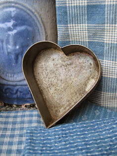 and another early tin heart mold, $58