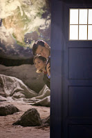The Doctor and Clara peek out of the TARDIS