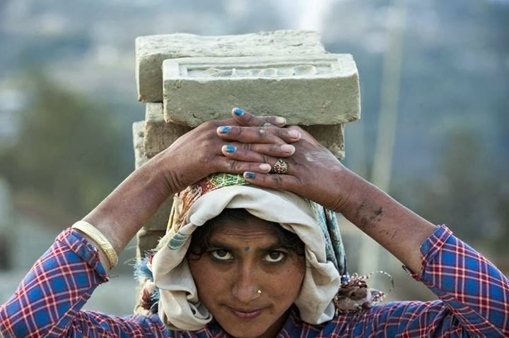 A worker carried bricks at a factory in Lalitpur, Nepal, Monday.