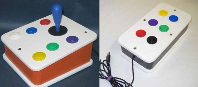 D.I.Y. Talking Joystick Mouse. Brightly coloured joystick with push buttons on the left-side, and a push-button box on the right.