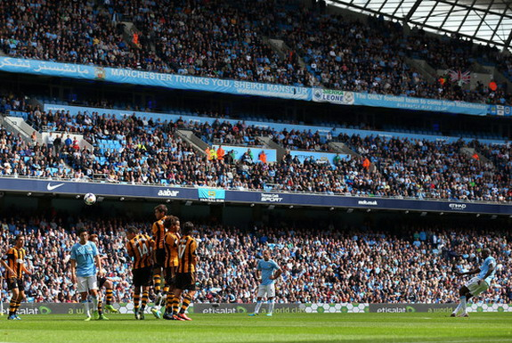 Manchester City player Yaya Touré scores his side's second goal against Hull from a free-kick