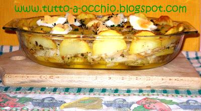 Baccalà al forno con patate e cipolle