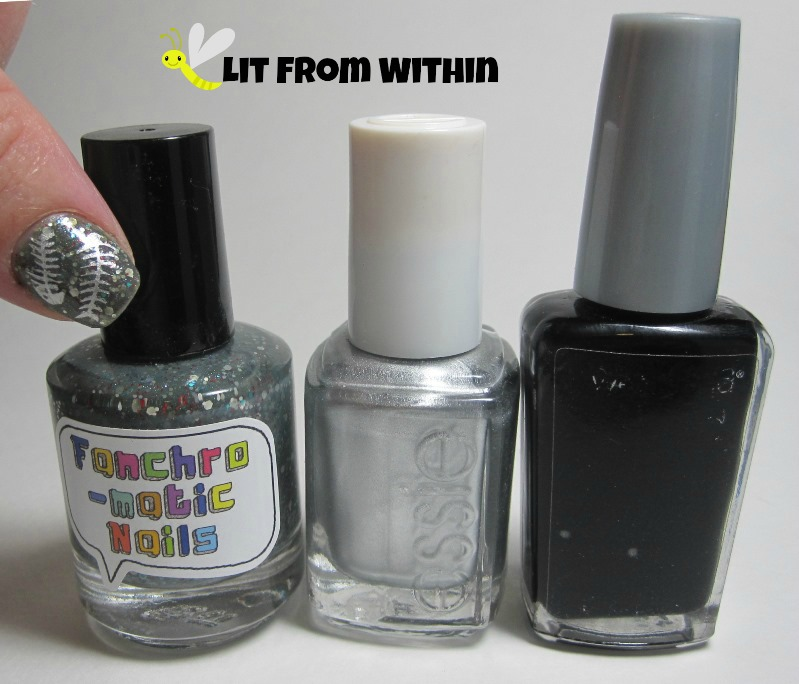 Bottle shot: Fanchromatic Nails To The Edge Of Night,  Essie No Place Like Chrome, and Wet 'n Wild Black Creme.