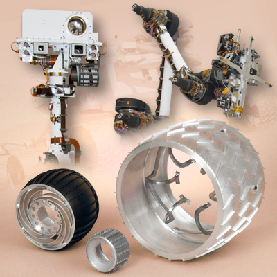 Mars Science Laboratory (MSL) Curiosity. Turret with camera on top. Arm will have multiple instruments mounted on its free end. At the bottom a comparison of the rovers' wheel sizes: Pathfinder, Opportunity and Curiosity on the left. NASA + JPL + Ren@rt, 2011.