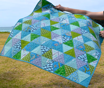 blue green sixty degree triangle baby quilt