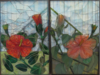 "Both sides of glass on glass mosaic titled ""Fire and Rain"" by Linda Pieroth Smith, as viewed in the sunlight."