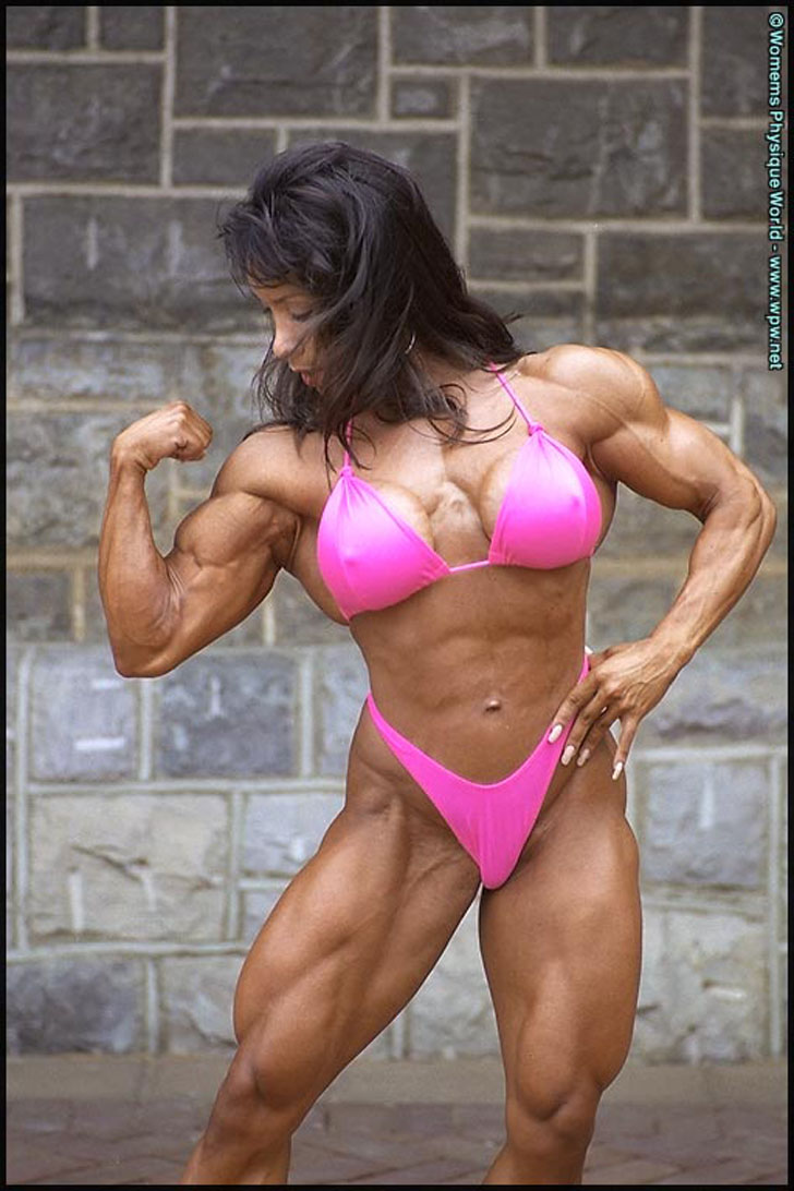 Denise Masino Flexes Her Muscles In A Pink Bikini