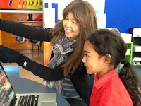Ms. She directing a student in her classroom