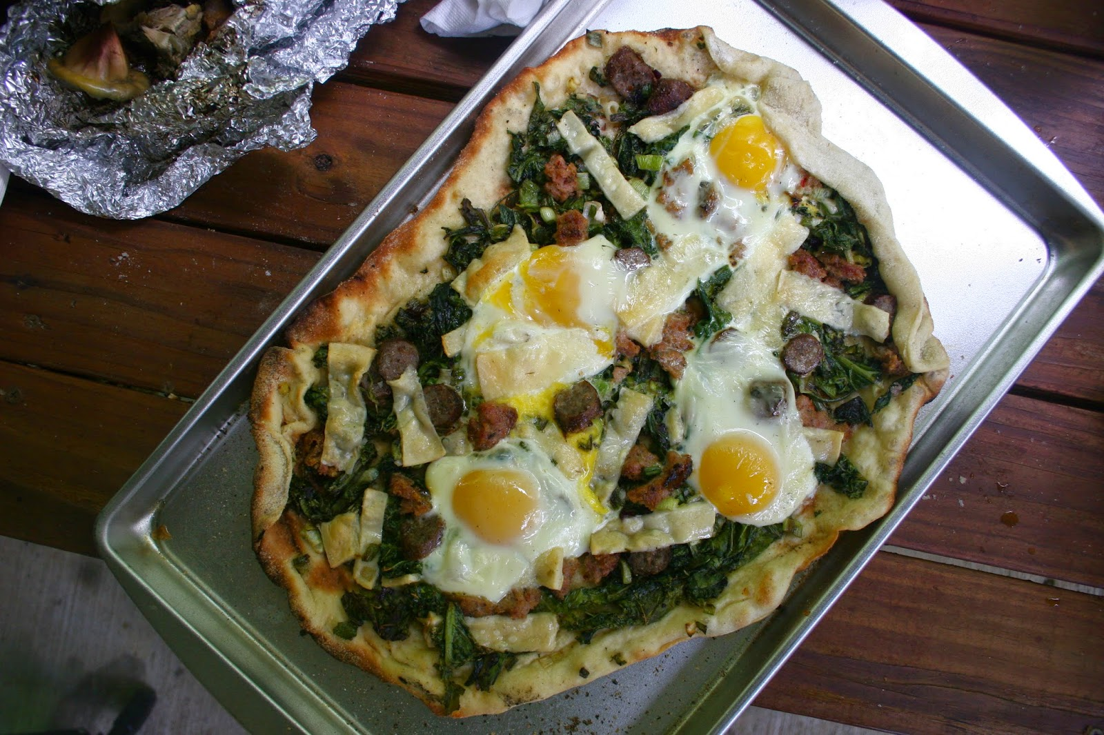 "Breakfast Pizza with Sausage, Greens, and Fried Eggs aka ""The Dwight Yolkum"""