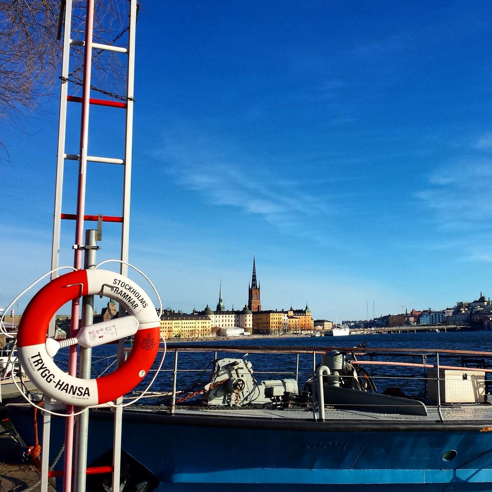 View of Gamla Stan from Norr Mälarstrand + Trygg-Hansa in Stockholm  |  Blue skies along Norr Mälarstrand on afeathery*nest  |  http://afeatherynest.com