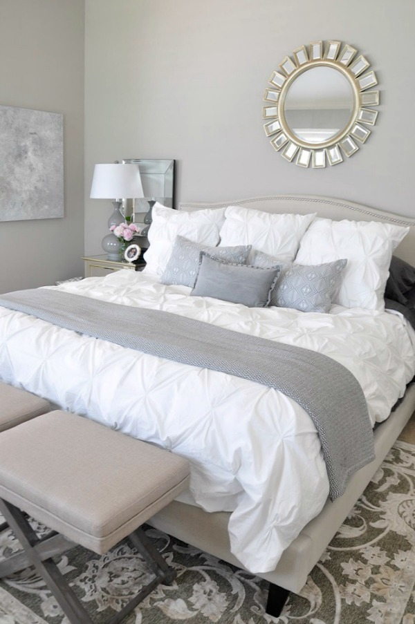 neutral master bedroom, white bedding with neutral rug grey accents, abstract art