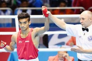 Pugilist Shiva Thapa is declared winner during preliminaries of the men's 56kg category boxing event at the 17th Asian Games. (PTI Photo)