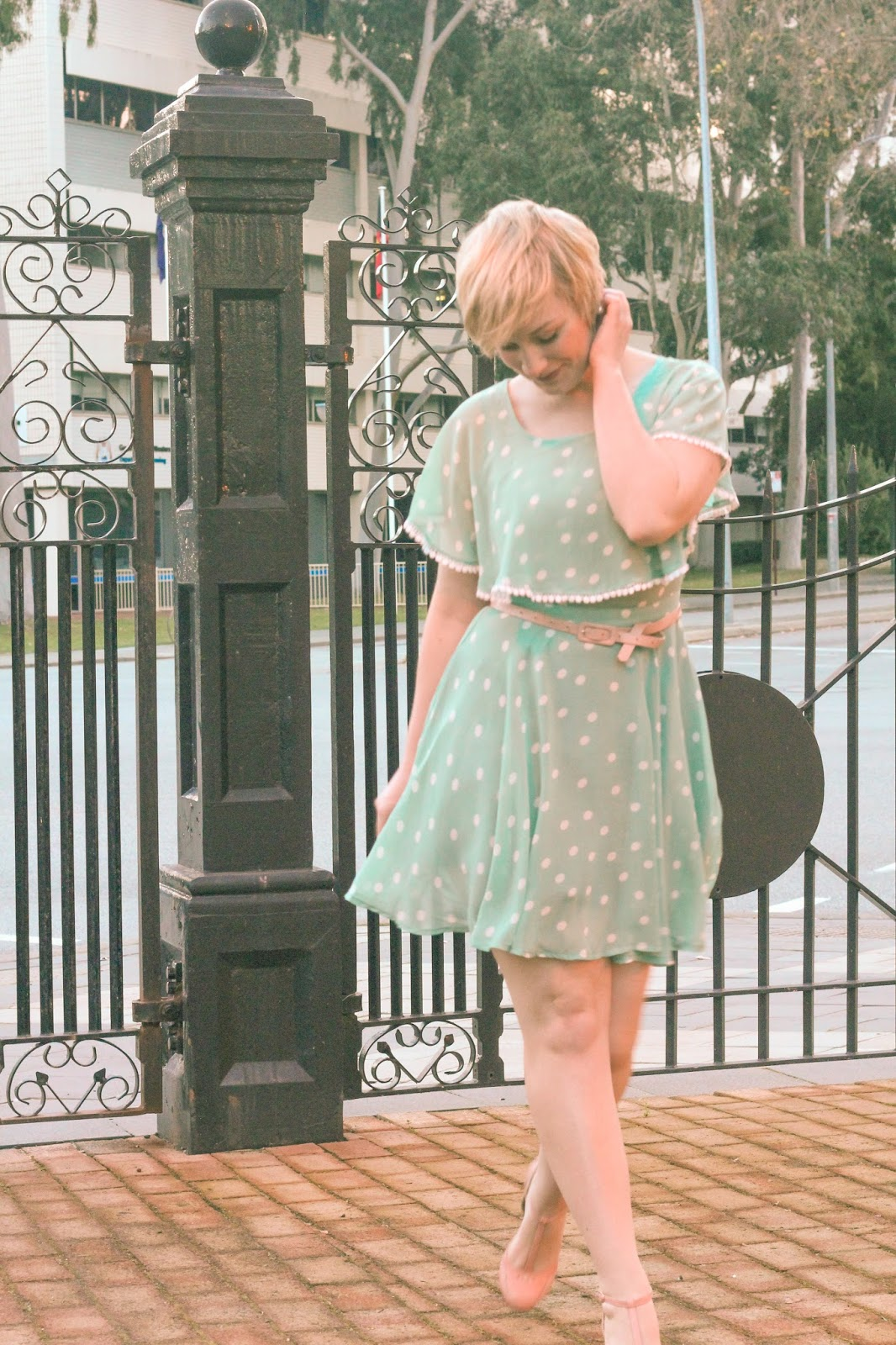 Liana of Finding Femme wears mint polka dot Modcloth dress, pint bettie page shoes and pixie cut.