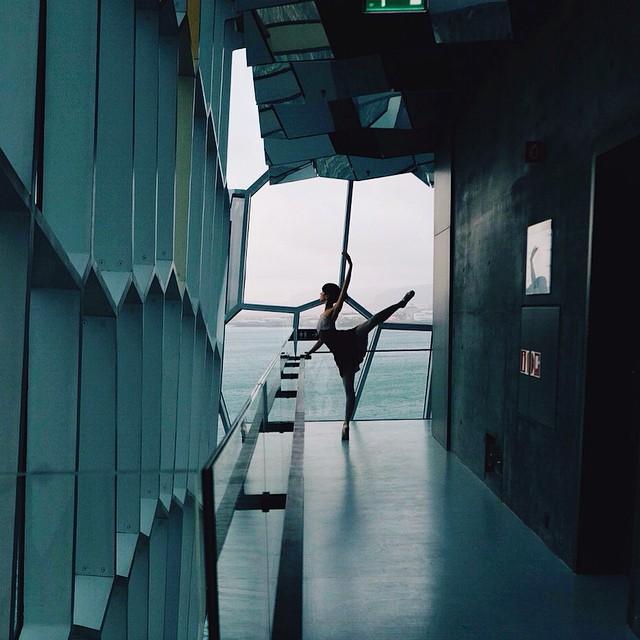 russian ballerina practicing in front of window