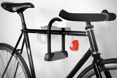 metal wall-mounted bike rack - accommodates a lock