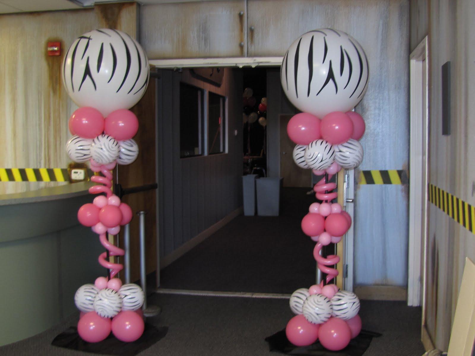 Two Jumbo Zebra Print Columns greet guest